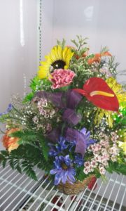 Bursting With Color Flowers in Basket
