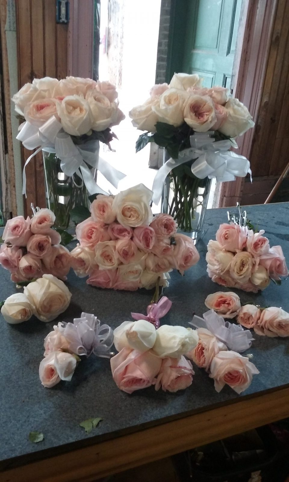 all-pale-pink-roses-bridal-bouquet-and-vases