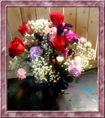 roses plus carnations and babies breath in vase with ribbon bow little falls florists