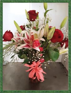 flower arrangement with roses and lilies